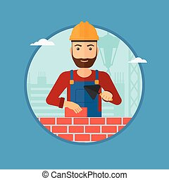 Bricklayer with spatula and brick - A hipster bricklayer in...