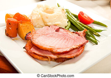 Ham Dinner - Spiral Sliced Ham on plate with Vegetables