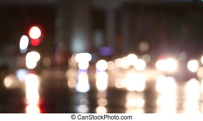 Defocused night traffic lights on a Rainy Day in...