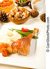 Turkey Leg - Turkey leg on square plate with vegetables