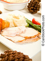 Turkey Breast - Sliced turkey breast on square plate with...