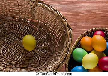 Easter colored eggs on the wooden background