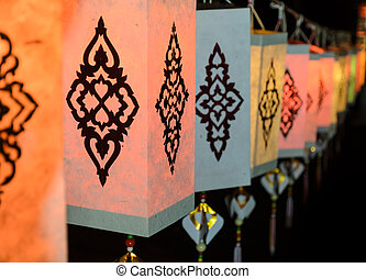 Lanna paper lantern illuminated at night in Thailand -...