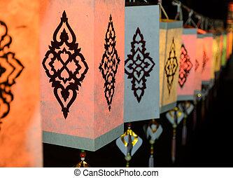 Lanna paper lantern illuminated at night in Thailand -...