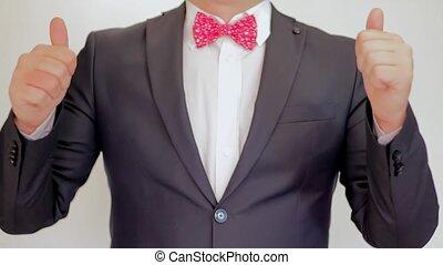 Businessman showing thumbs up - closeup shot. Success
