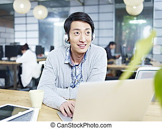 young business person working in office - young asian...
