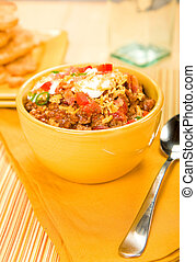 Chili - Deluxe chili topped with sour cream, bacon,...