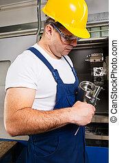 man worker measuring steel