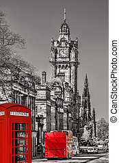 Edinburgh with phone booths and red bus against clocktower...