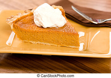 Sweet Potato Pie with a dollop of freshly whipped cream