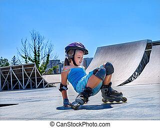 Girl riding on roller skates in skatepark. - Little girl...