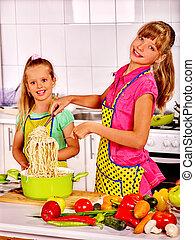 Children cooking spaghetti at kitchen. - Children eating and...