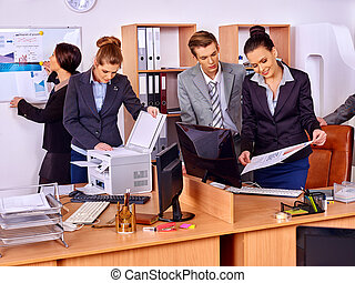 Happy group business people are printing out in office -...