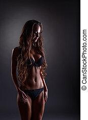Slender girl with long hair posing in lingerie - Slender...