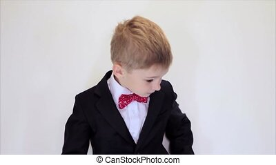 Cute kid play businessman, concentrated at work, talking on the phone. Success