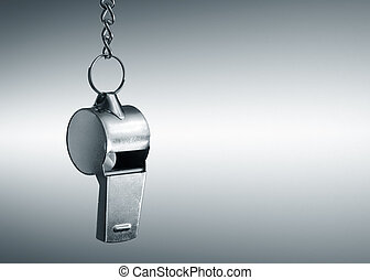 Hanging metal whistle closeup photo