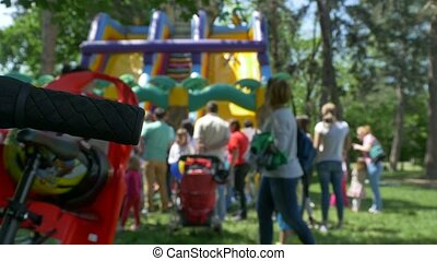 Kids at Inflatable Slide - Lot of children jumping and...