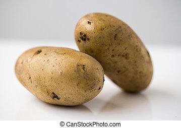 Potato isolated on white background close up