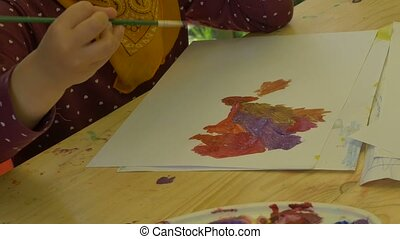 Child Painting with Tempera Paints - Child is painting on a...