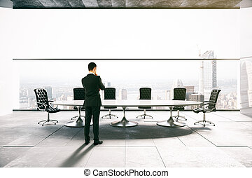 Thoughtful man in conference room - Thoughtful businessman...