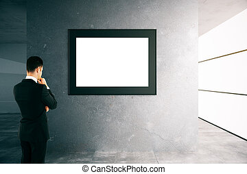 Thoughtful man looking at frame - Thoughtful businessman...