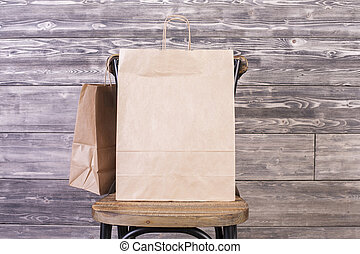 Empty shopping bag - Chair with blank shopping bag and...