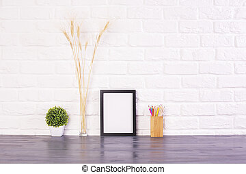 Blank picture frame, pencil holder, plant and wheat spikes...