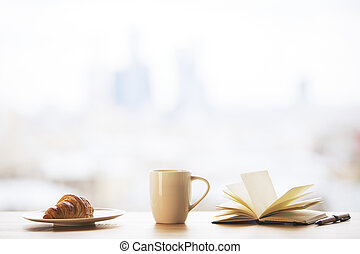 Desktop with coffee and book - Desktop with tall coffee cup,...
