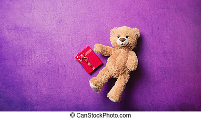 gift and teddy bear - red gift and cute teddy bear on the...