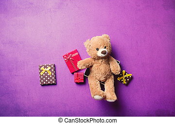 gifts and teddy bear - gifts and cute teddy bear on the...