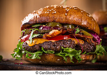 Tasty burgers on wooden table. - Close-up of home made tasty...