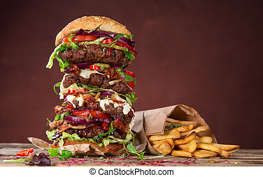 Tasty big burger on wooden table. - Close-up of home made...