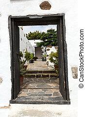 Old black entrance gate in Betancuria village on on...