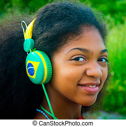 Brazilian girl scolta music while waiting for the Olympic...