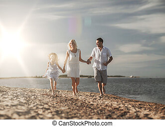 happy family at the seaside - summer holidays, children and...