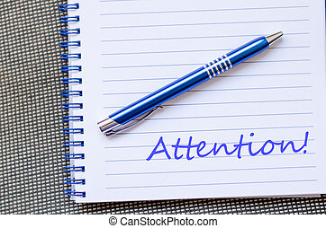Attention write on notebook - Attention text concept write...