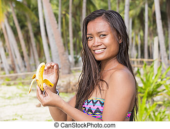 Filipina girl eating banana - Filipina beautiful girl eats a...
