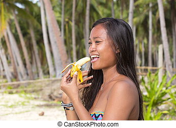 Filipina girl eating banana - Filipina beautiful girl eats a...