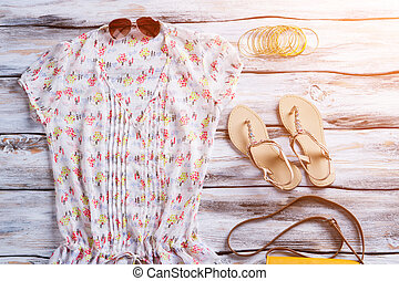 V-neck blouse with bright pattern. Blouse, sandals and...