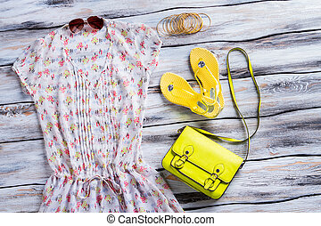Yellow flip flops and blouse. Lime purse, blouse and...