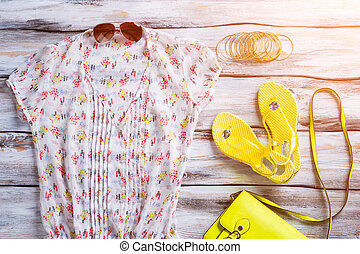 V-neck blouse and flip flops Womans yellow footwear and...