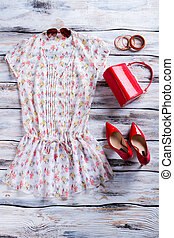Blouse and red heel shoes. Bright red purse with blouse....