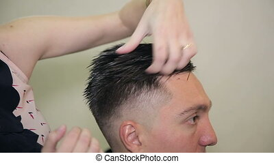 Barber lay hair of man in beauty saloon. - Professional...