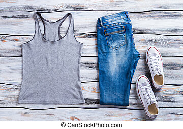Gray tank top and jeans. White shoes with tank top. Girl's...