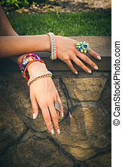 summer trendy bijou - closeup of female hands with colorful...