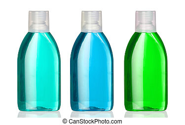 Three bottles of mouthwash with reflection on white...