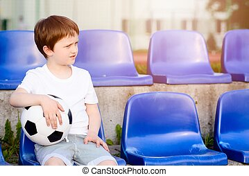 Small football fans disappointed after the loss goal by his...