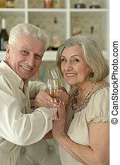 happy Senior couple with wine - happy Senior couple resting...