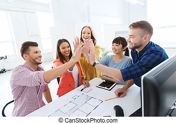 creative team making high five at office - business,...