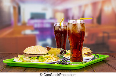 Two servings hamburgers, french fries, cola and sauce. - Two...